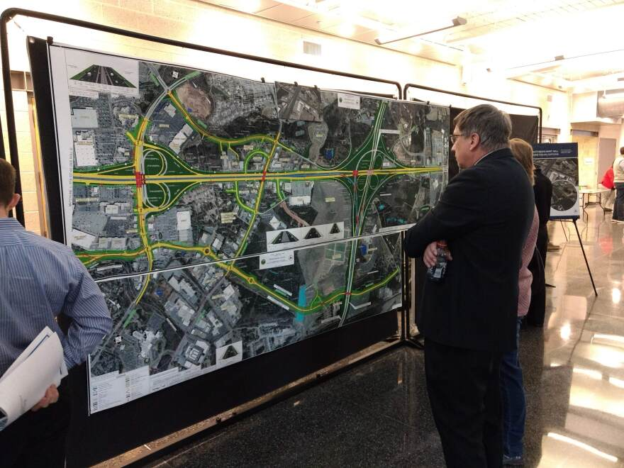 Residents examined section maps of the planned U.S. 74 widening project Tuesday at CPCC in Matthews.