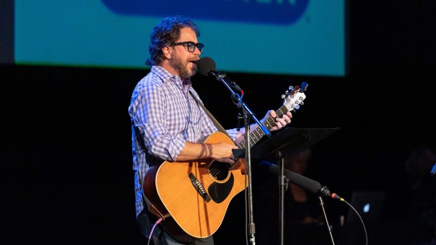 <em>Ask Me Another</em> house musician Jonathan Coulton performs at the Aztec Theatre in San Antonio, Texas.