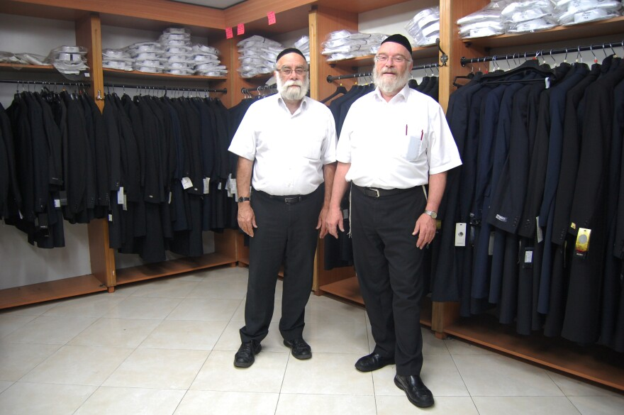 Yechiel Rubin, at left, and his brother Simcha run a men's clothing shop catering to ultra-Orthodox Jews in Jerusalem. They advise short linings and 100 percent wool as the coolest coat for the summer.