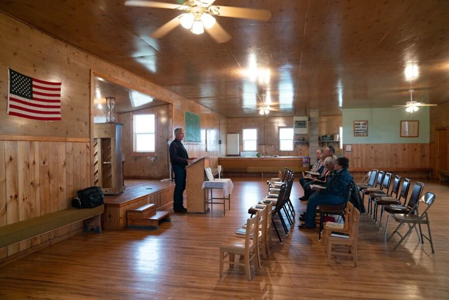 Photo of pastor Hal DeBoer preaching.