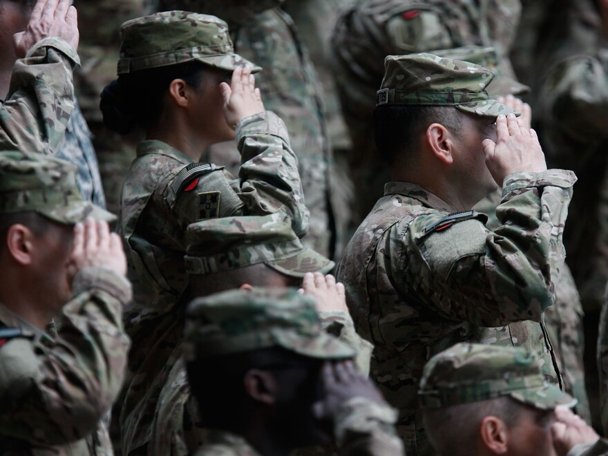 Soldiers of the U.S. Army V Corps conduct a color casing ceremony to mark the departure of V Corps headquarters from Europe on May 10, 2012, at the U.S. Army base in Wiesbaden, Germany.