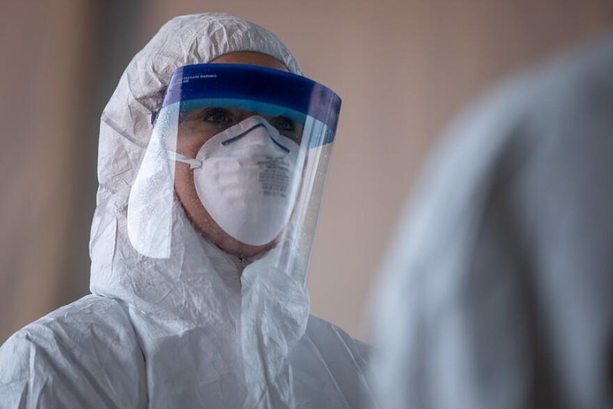 Coronavirus health worker in a protective suit.