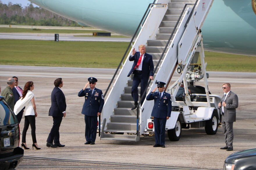 Trump stepping off of his plane to tour Tyndall Air Force Base.