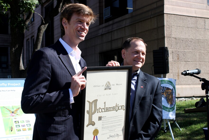 National Wildlife Federation President Collin O'Mara poses with St. Louis Mayor Francis Slay. The two pledged Saturday, Sept. 19, 2015 to encourage mayors across the nation to help restore monarch habitats.