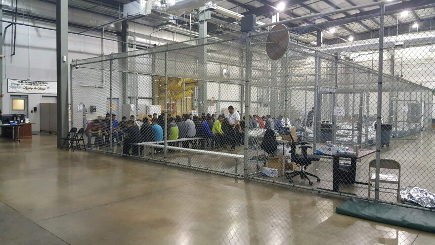 In a handout photo, the inside of a U.S. Customs and Border Protection detention facility shows detainees inside fenced areas at Rio Grande Valley Centralized Processing Center in Rio Grande City, Texas, on June 17.