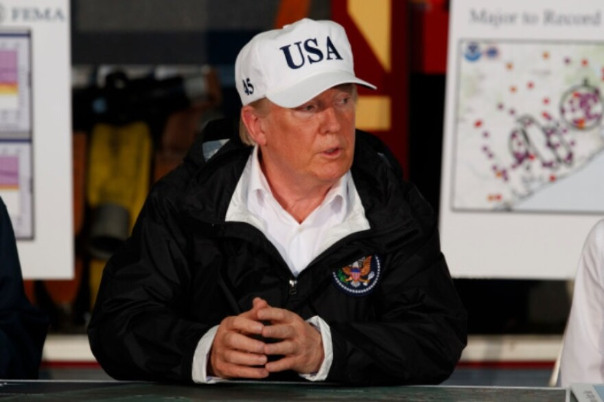 President Donald Trump participates in a briefing on Harvey relief efforts, Tuesday, Aug. 29, 2017, in Corpus Christi, Texas.