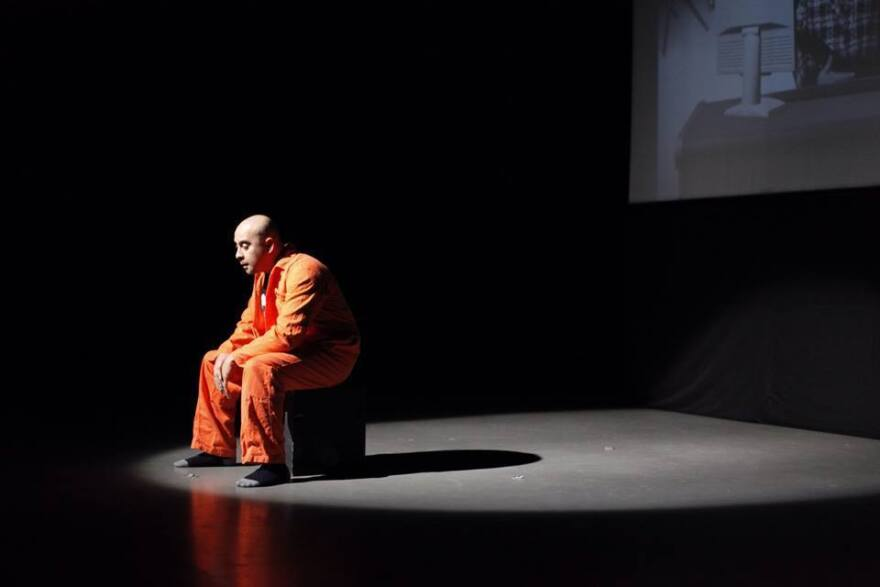 Performing in his play <em>Djihad</em>, writer/director and lead actor Ismaël Saïdi plays a character lamenting his life in prison upon returning from fighting in Syria. <em></em>