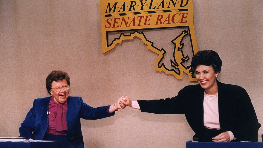 Mikulski (left) and her then-opponent Linda Chavez hold hands before the Maryland Senate candidates debate in 1986.