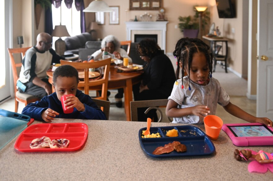 """Four generations living together has its advantages, including financial support, child care and shared meals. Michael """"Amir"""" Nimrod and his sister, Maleeya, have breakfast with everyone at the Walker residence."""