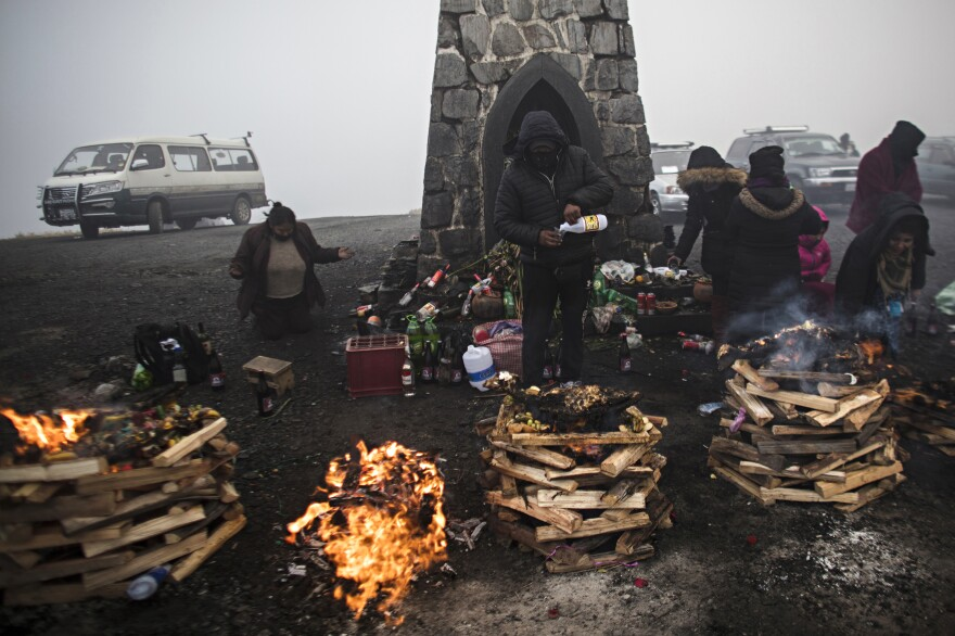 Pandemic or no, indigenous Bolivians celebrate the Mother Earth goddess Pachamama persists in Bolivia. These men and women gave offerings to the goddess in a high-altitude summit in Yungas, a forested ecoregion some 2.8 miles above sea level. <em>August 16. La Paz.</em>
