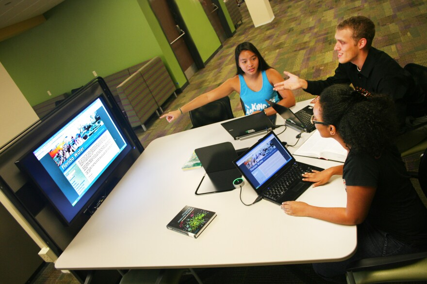 3_students_studying_learning_commons.jpeg
