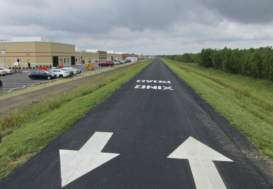 The paved trail atop the Monarch levee just beyond the Taubman Prestige Outlets mall in Chesterfield Valley.