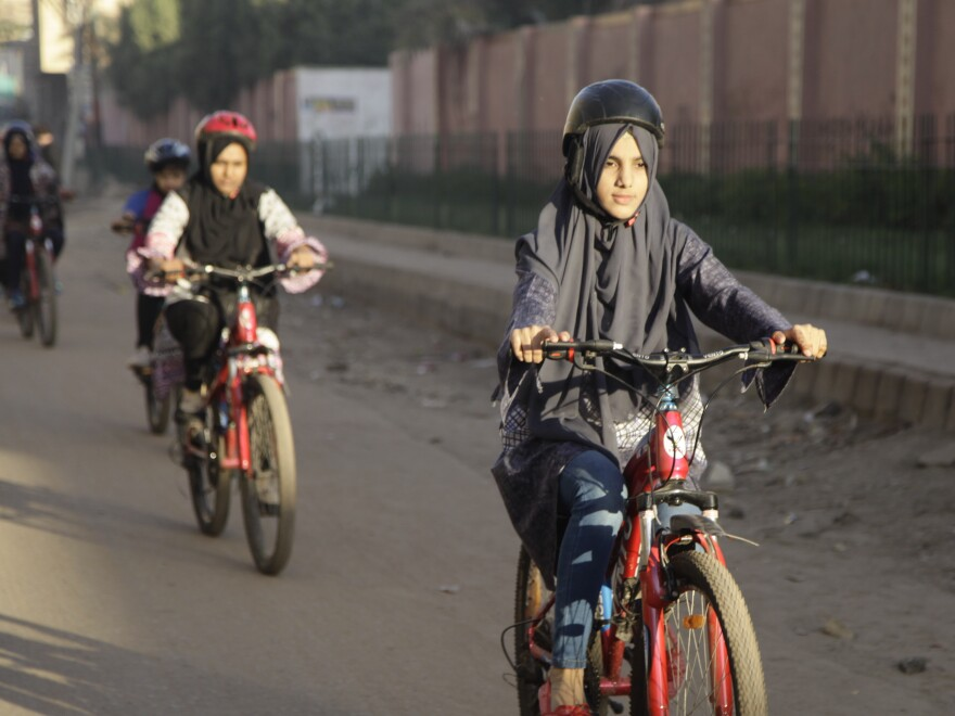 Zulekha Dawood leads female cyclists through a neighborhood in Karachi, Pakistan. They ride early in the morning to avoid the worst of traffic.