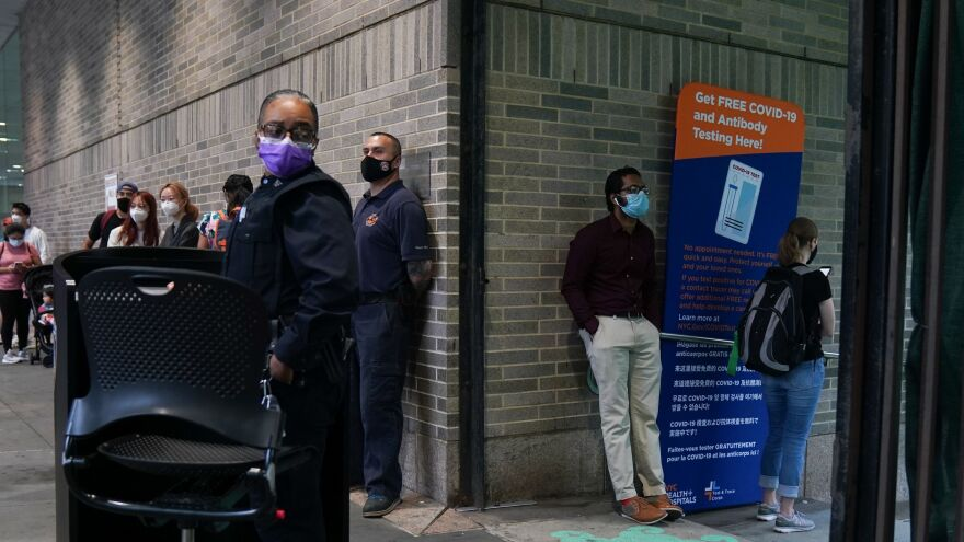 People stand in line for free coronavirus testing this month at Bellevue Hospital in New York City. The daily number of new coronavirus cases reported in the U.S. has remained stubbornly high.