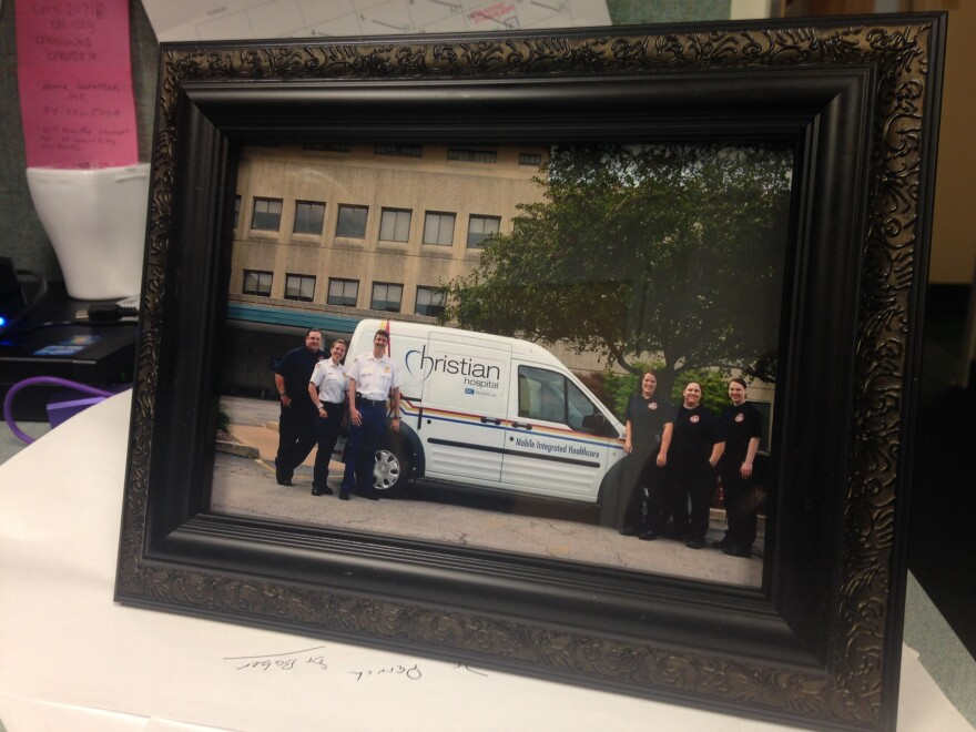 A photo of members of the mobile health team sits on a desk in the paramedics' group office at Christian Hospital.