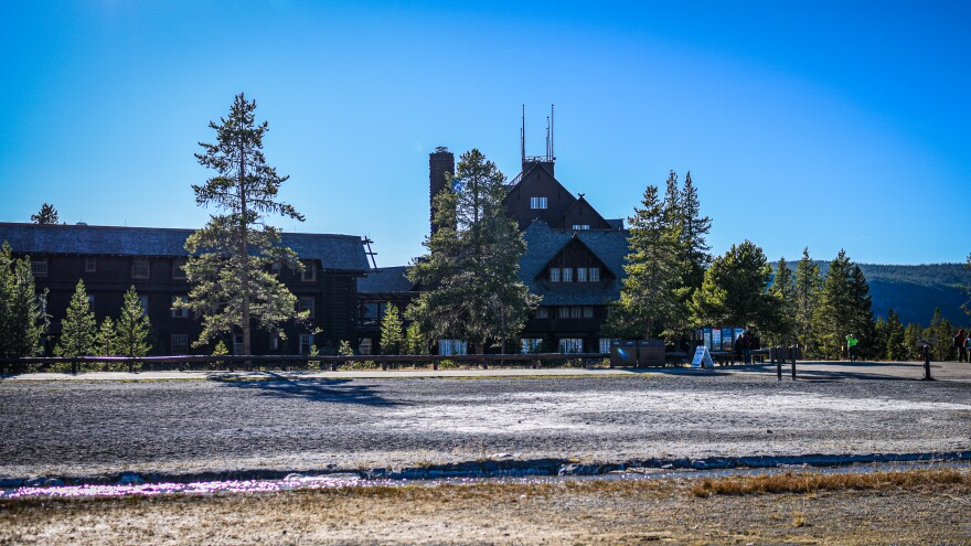 Old Faithful Inn, built in 1903, inspired the rustic log architecture in national parks across America. During the 1988 fires, firefighters embarked on a massive effort to save the hotel from the flames.