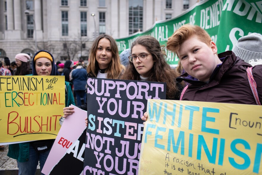Bryana Moore, Veronika Funke, Nancy Haugh, students at James Madison University (JMU), and Katie Lese, a lecturer at JMU, traveled to Washington, D.C. for the Women's March.