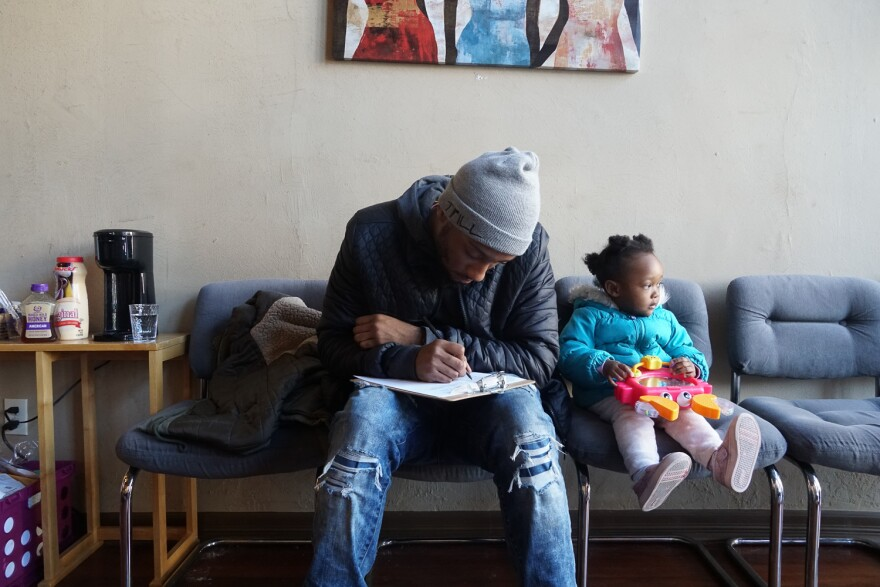 A Jamaa Birth Village client fills out paperwork to receive chiropractic care. March 4, 2019.