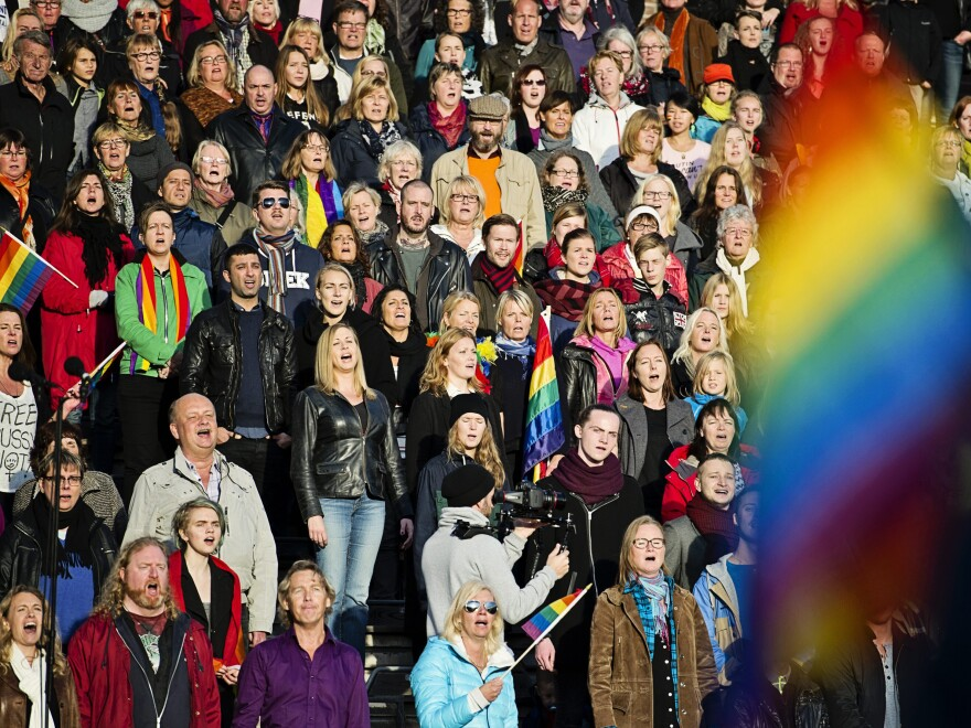 People gather at the Stockholm Olympic Stadium in 2013 to show support for the lesbian, gay, bisexual and transgender community of Russia.