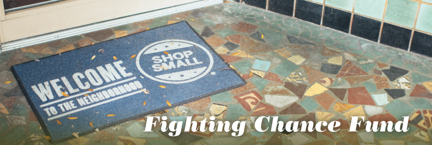 """Welcome mat with the text  """"Fighting Chance Fund"""" overlaid"""