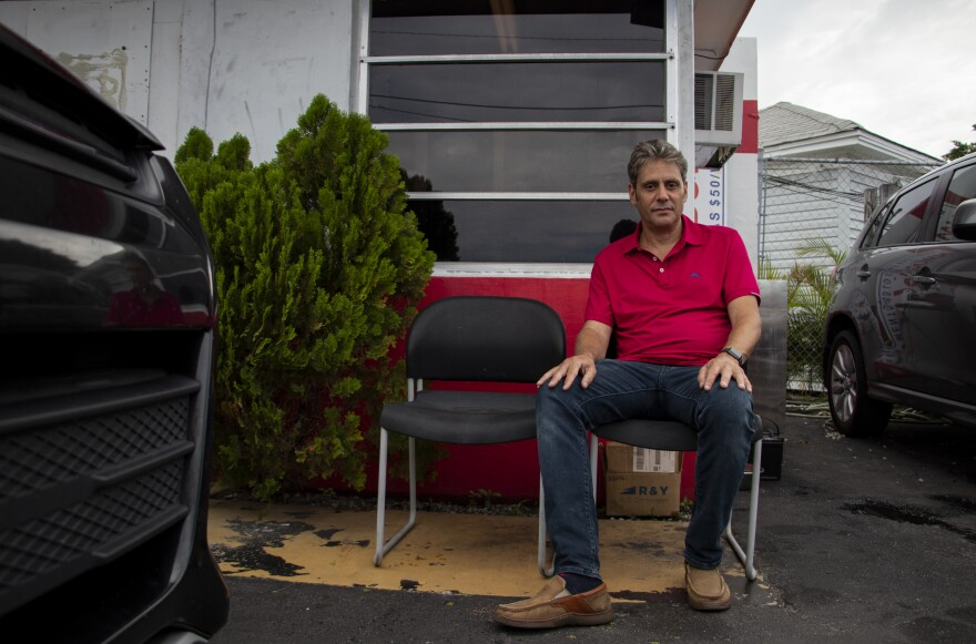 William Abramson sits outside the office of Auto Solutions of South Florida, LLC in West Palm Beach. Abramson filed a lawsuit against Gov. Ron DeSantis shutdown orders during the coronavirus pandemic.