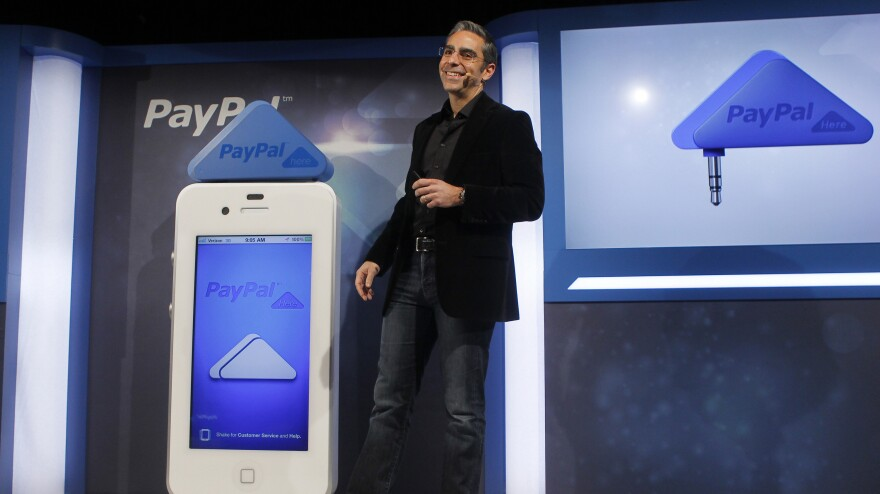 David Marcus, president of PayPal, unveils PayPal Here in San Francisco in March. The service allows customers to use their smartphones to pay for purchases at retail stores.