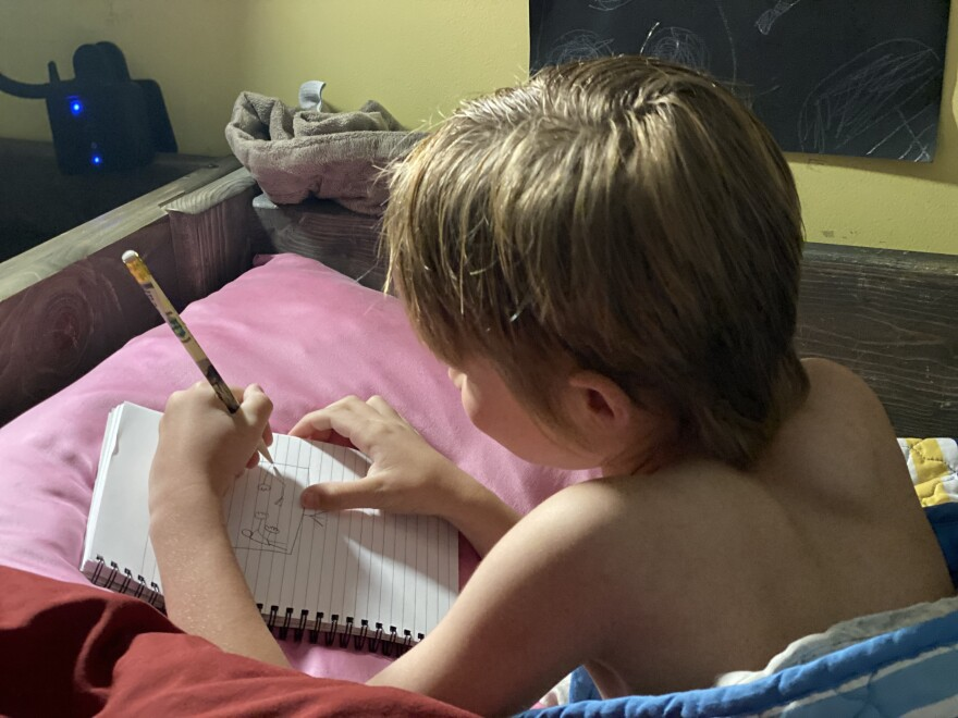 Photo of a child drawing.