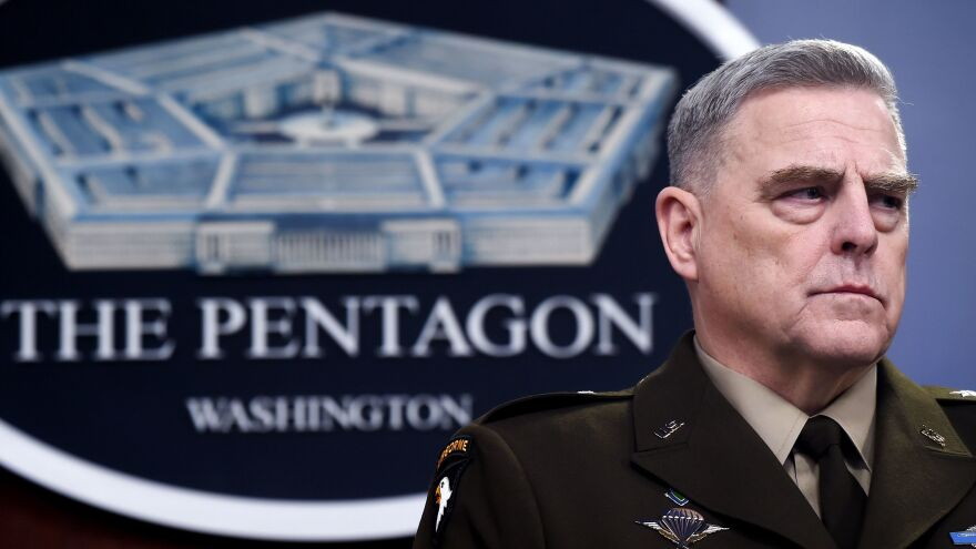 "Gen. Mark Milley, chairman of the Joint Chiefs of Staff, attends a media briefing earlier this year at the Pentagon. He told NPR on Thursday that the U.S. military is still considering ""a whole series of protocols"" when it comes to the coronavirus."