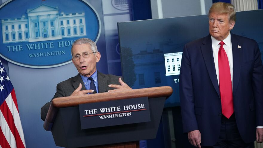 Dr. Anthony Fauci, director of the National Institute of Allergy and Infectious Diseases, speaks as President Trump listens during the daily briefing of the White House coronavirus task force on Monday.
