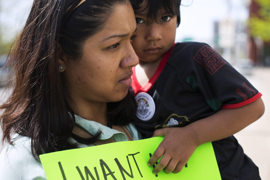 Mariana Flores holds her son, Jitzak Mejia, 4, outside the federal courthouse in St. Louis this past April. Immigration reform supporters gathered in cities across the country as the Supreme Court heard arguments in United States v. Texas on April 18.