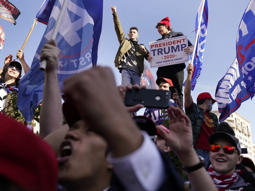Supporters of President Donald Trump attend a pro-Trump march in Washington, D.C. on Saturday.