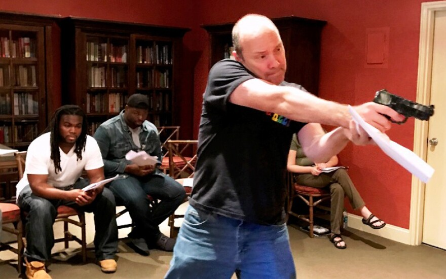 "Actor Dan Kelly aims his gun, as a cop in ""You Try It"" by Neil LaBute, part of the ""Every 28 Hours"" theater collaboration. Actors Joel Beard, Noble Montgomery and Theresa Masters look on."