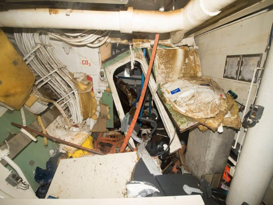 The lounge area of Berthing 2 on the USS Fitzgerald, looking toward its exit, as seen in a U.S. Navy report on the destroyer's collision in June.