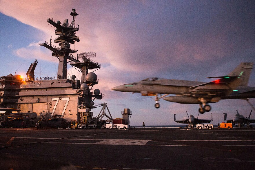 An F/A-18 Hornet lands on the deck of the U.S.S. George H.W. Bush in the Atlantic ocean on Oct. 25, 2017. (Andrew Caballero-Reynolds/AFP/Getty Images)