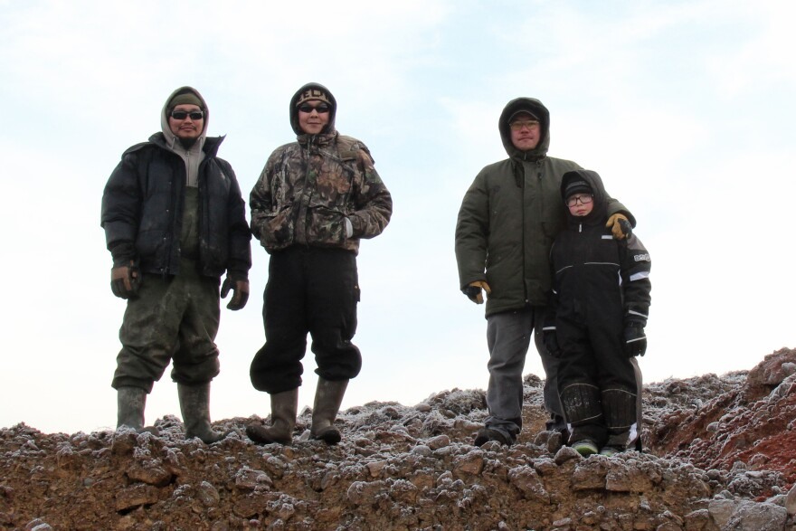 """Noah """"Robert"""" Waska (left), Dalen Ayuluk, Andrew John and Jason John stand above the rock quarry at Mertarvik, the site where Newtok residents hope to relocate their entire village."""