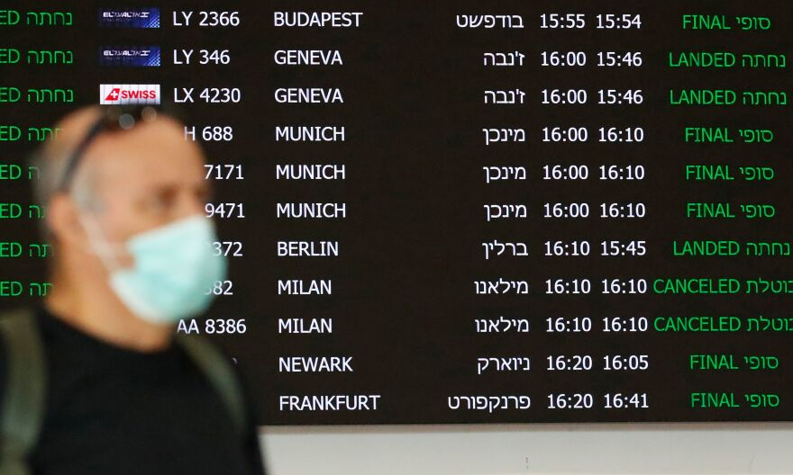 A flight information board displays canceled incoming flights from Italy at Ben Gurion Airport, near Tel Aviv, Israel, last month. Airlines are slashing hundreds of flights amid fear of the spreading coronavirus.