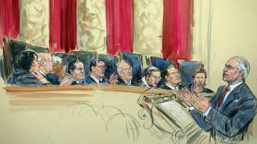 This artist rendering shows attorney Charles J. Cooper, who was defending California's voter-passed ban on gay marriage, addressing the Supreme Court on Tuesday. From left, the justices are Sonia Sotomayor, Stephen Breyer, Clarence Thomas, Antonin Scalia, (Chief Justice) John Roberts, Anthony Kennedy, Ruth Bader Ginsburg, Samuel Alito and Elena Kagan.