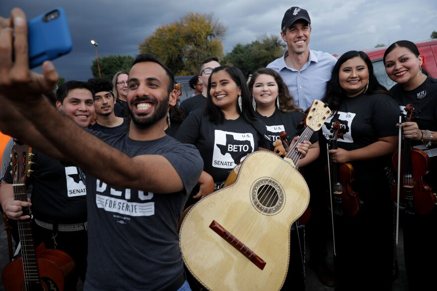 Then-U.S. Senate candidate Rep. Beto O'Rourke (D-Texas) poses with members of a mariachi band during an October 2018 campaign rally in San Antonio, Texas. O'Rourke is one of a score of Democratic politicians talking more explicitly about issues of race than previous generations of Democrats.