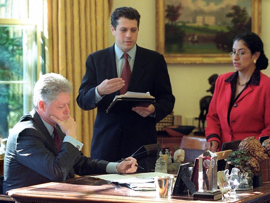 President Clinton goes over his 1999 State of the Union speech with speechwriter Michael Waldman and deputy chief of staff Maria Echaveste.