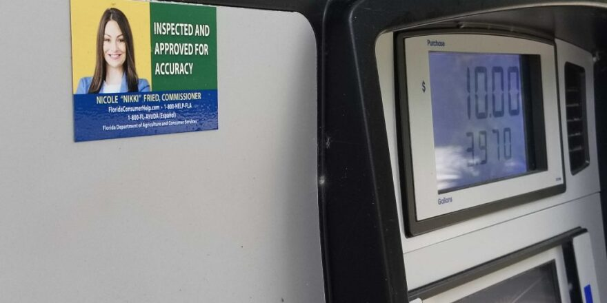 A Florida Department of Agriculture inspection sticker on a Gainesville gas station pump displays an image of Commissioner Nikki Fried.