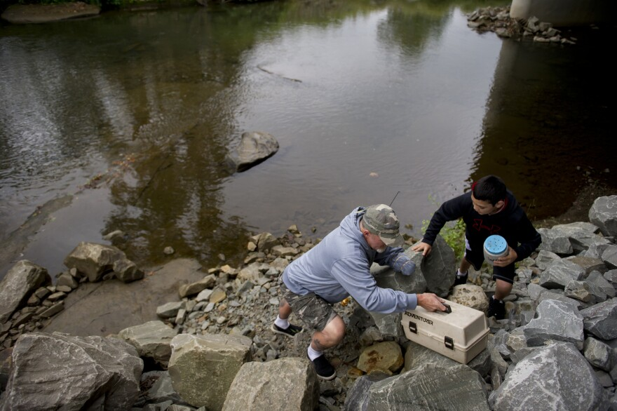 Whedbee fishes for trout with his grandson, Mason, in Two Lick Creek in Homer City, Pa.