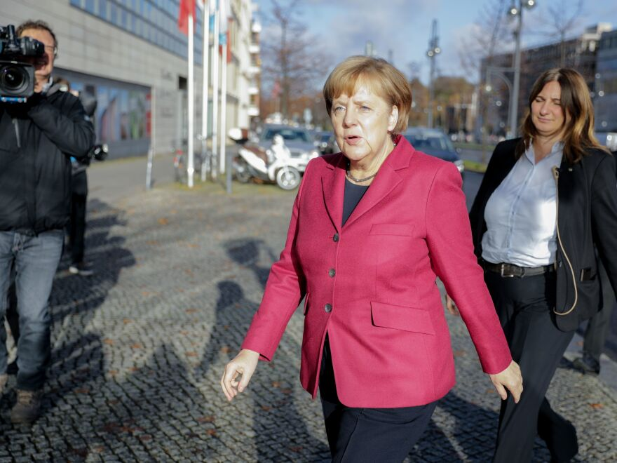 German Chancellor Angela Merkel arrives at her Berlin party headquarters Friday for talks with members of potential coalition parties to form a new government.