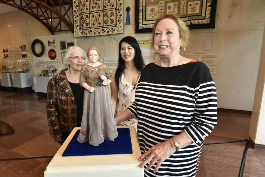 W.Va. First Lady Cathy Justice unveils a doll in her likeness on June 27, 2018.
