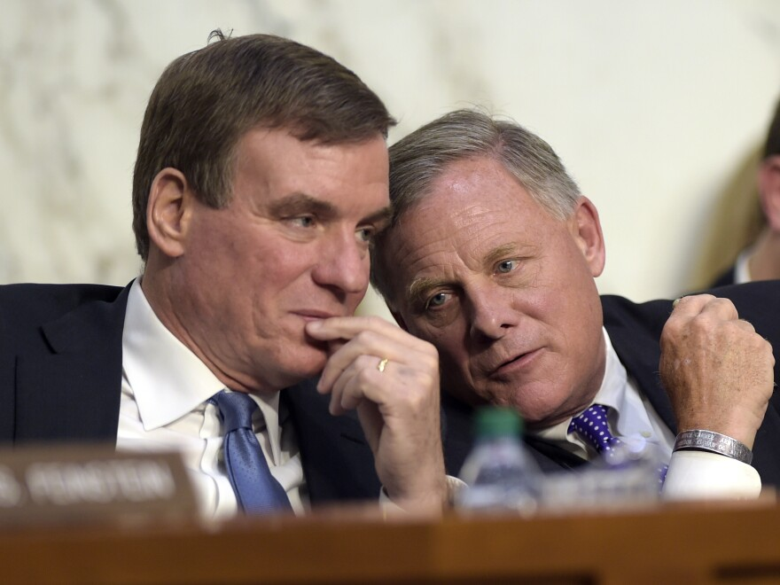 Senate Intelligence Committee Chairman Richard Burr, R-N.C. (right), and Vice Chairman Sen. Mark Warner, D-Va., confer. Their committee's hearing was closely watched and has been heavily analyzed.