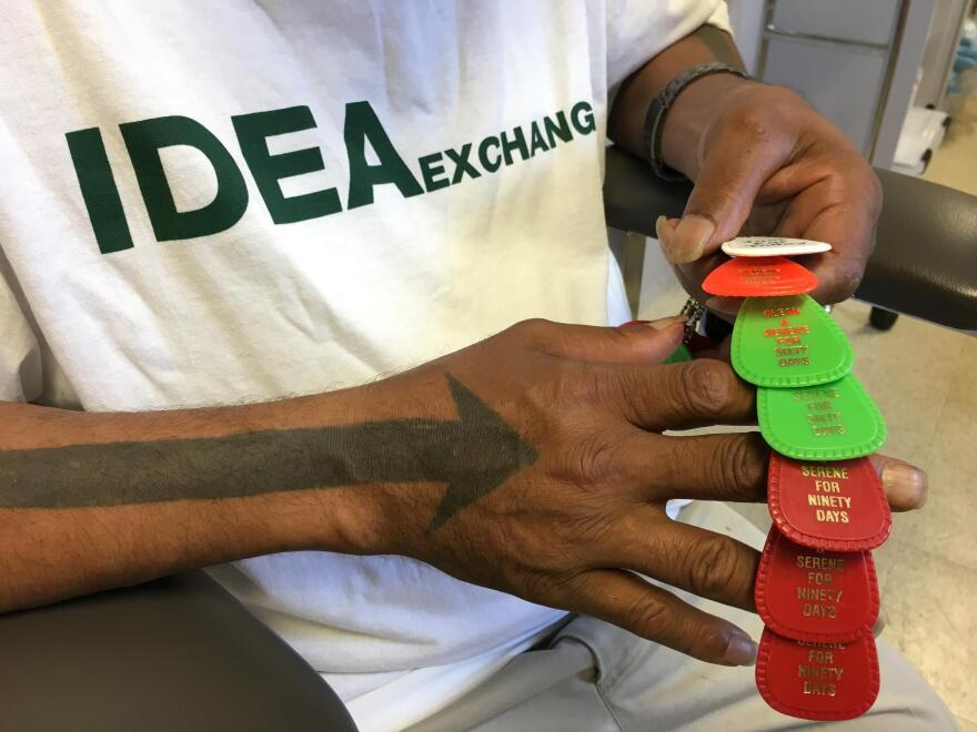 During one of his visits to the needle exchange van in Miami, Arrow was referred to inpatient drug treatment. Here, he displays keyrings marking milestones of his sobriety.