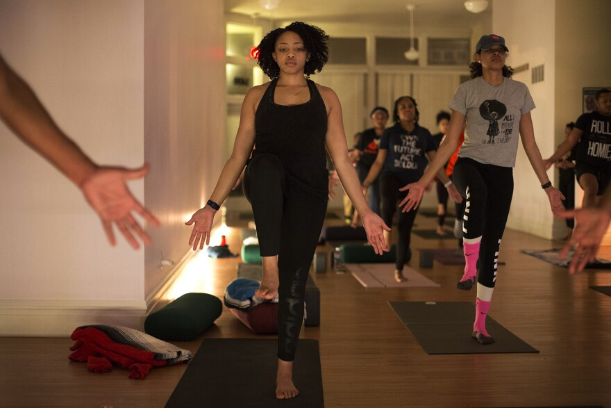 The donation-based yoga program offers a fusion of yoga practices. Ericka Harris said before she begins her sessions she scans the room to see if she needs to change her yoga routine to accommodate her students vibes.