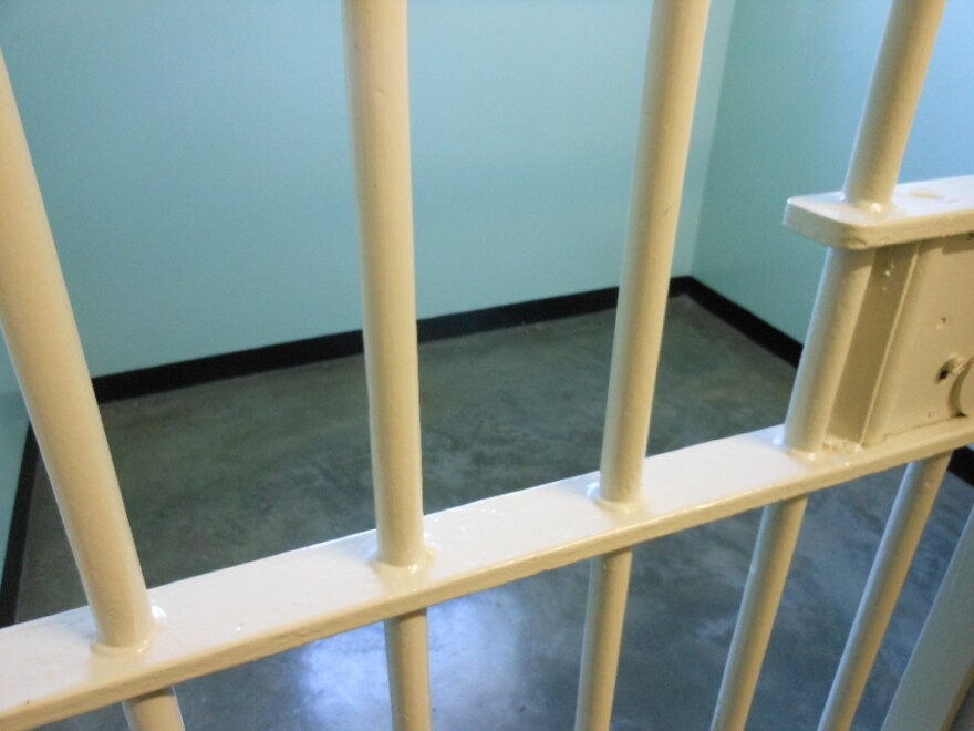 close up of bars in a jail cell