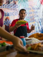 Carlos Fonseca Leal, one of the 14 Cuban employees at Little Habana, serves food during a recent lunch rush.