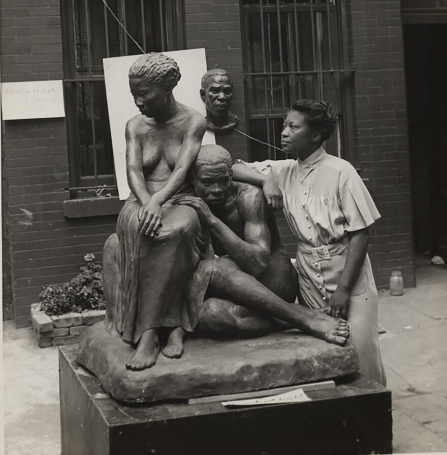 Augusta Savage was an artist, educator, activist and community leader. Her work is the focus of an exhibition at the New-York Historical Society, organized by the Cummer Museum of Art & Gardens. She's pictured above with her 1938 sculpture <em>Realization.</em>