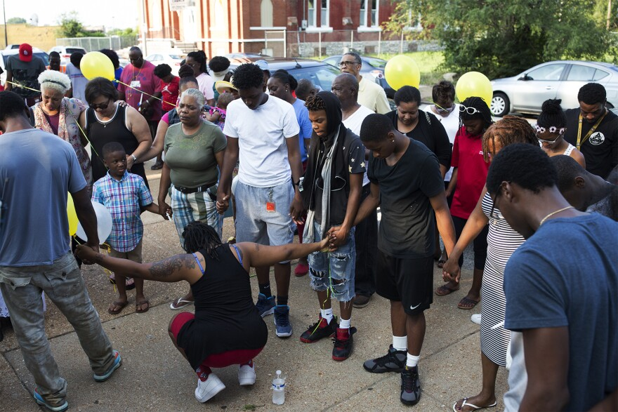 Family, friends and colleagues remember Jacara Sproaps outside Dunbar Elementary.
